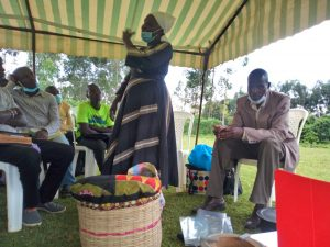Mama Florence spreads the word in a public meeting